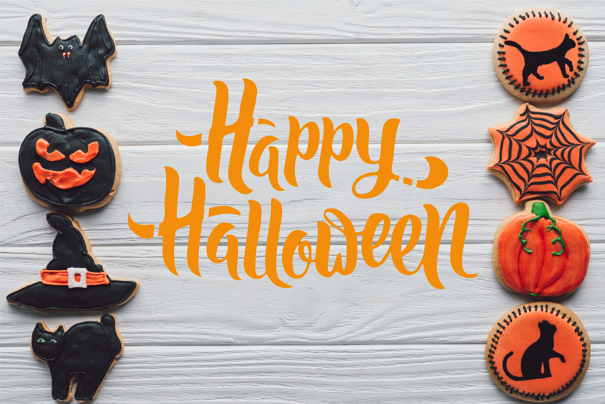 text says Happy Halloween and pictures are cookies on a background